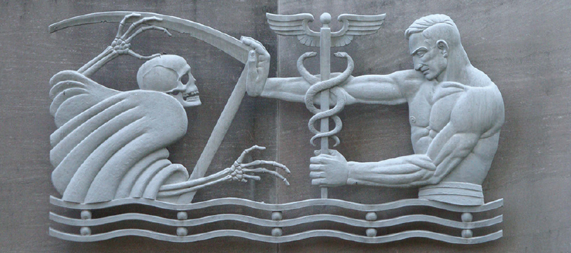 """<p>Figure. The concept of the doctor as a superhuman master over death is not new. In Julian Hoke Harris' sculpture """"Keeping Back Death,"""" a physician wields the Rod of Asclepius (depicted as a caduceus) to fend off the personification of death.</p>"""